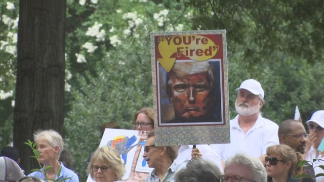 Demonstrators rally against immigration policy at Kelly Ingram Park