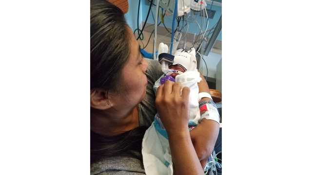 Mom unexpectedly goes into labor at Six Flags, delivers baby at water park